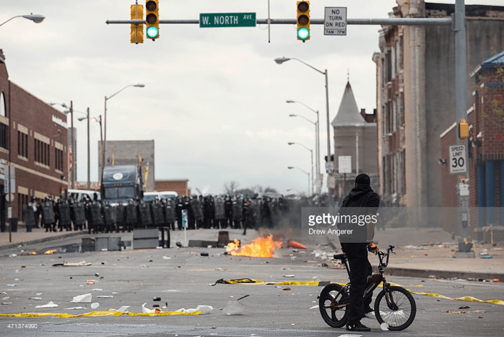 http://www.gettyimages.com/event/protests-in-baltimore-after-funeral-held-for-baltimore-man-who-died-while-in-police-custody-551557375#with-baltimore-police-officers-in-riot-gear-lining-the-street-a-man-picture-id471374990