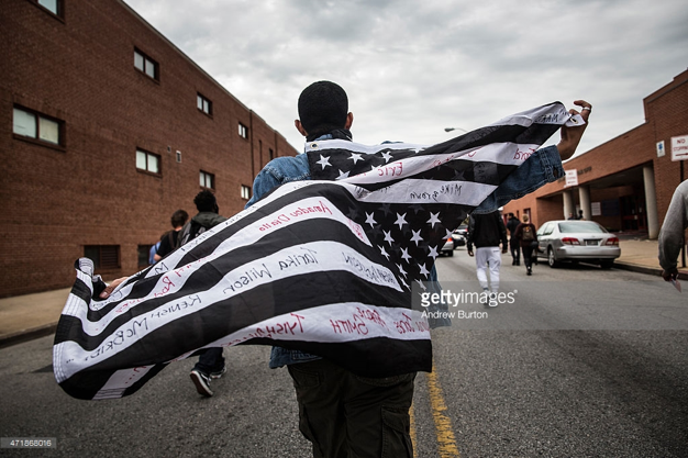 http://www.gettyimages.com/event/criminal-charges-announced-against-baltimore-police-officers-in-freddie-grays-death-552256169#protesters-march-through-the-streets-in-support-of-maryland-state-picture-id471868016