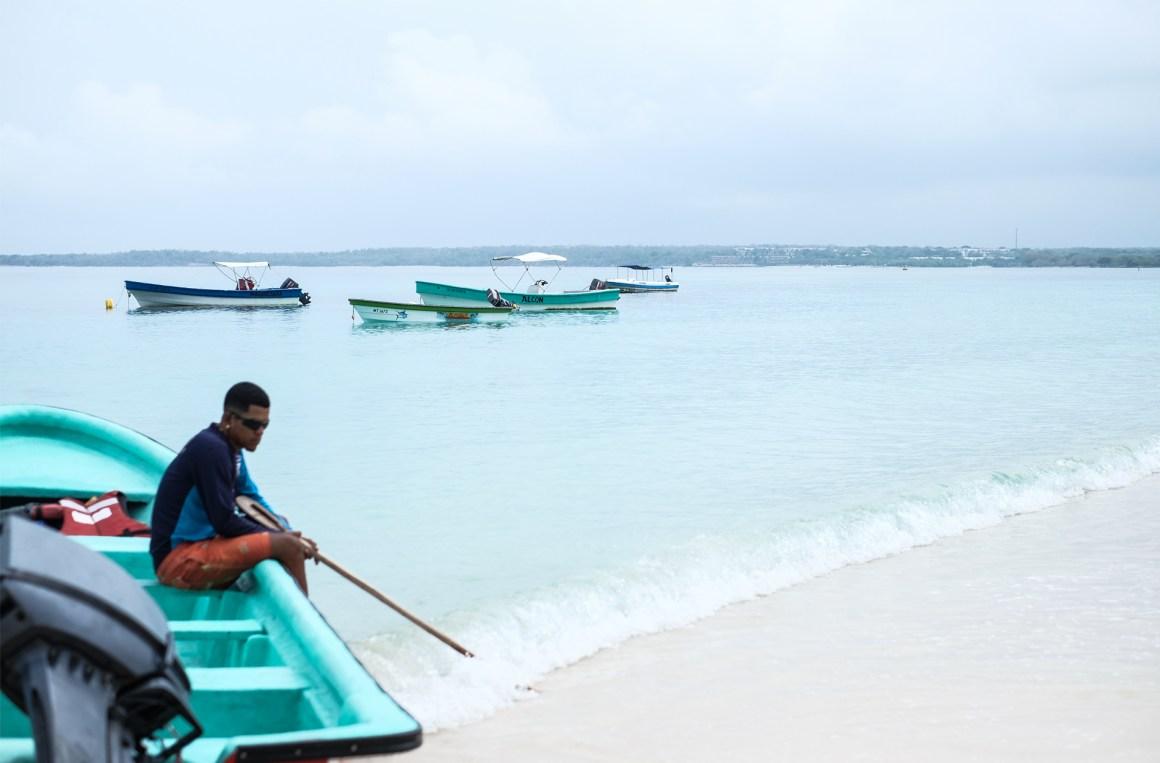 playa blanca blue beach man boat teal
