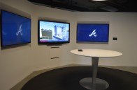 Meeting rooms feature three big touch screen displays that allow members to virtually experience the park.