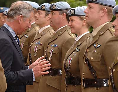 Prince Charles sizes things up