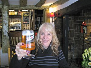 Carla downs a pint in the historic Windmill Inn