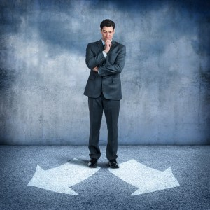 istockbusinessman-looking-at-two-arrows-pointing-in-opposite-directions-000062915734_xxxlarge