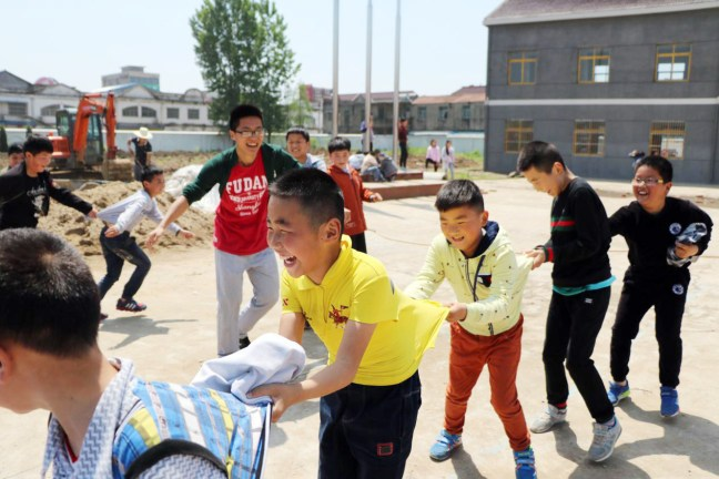 School of Management Fudan University, China's leading business school, steps into primary and secondary education, helping teachers and pupils in the rural mountain region of Huoqiu with the 5th Young Activity Initiative.