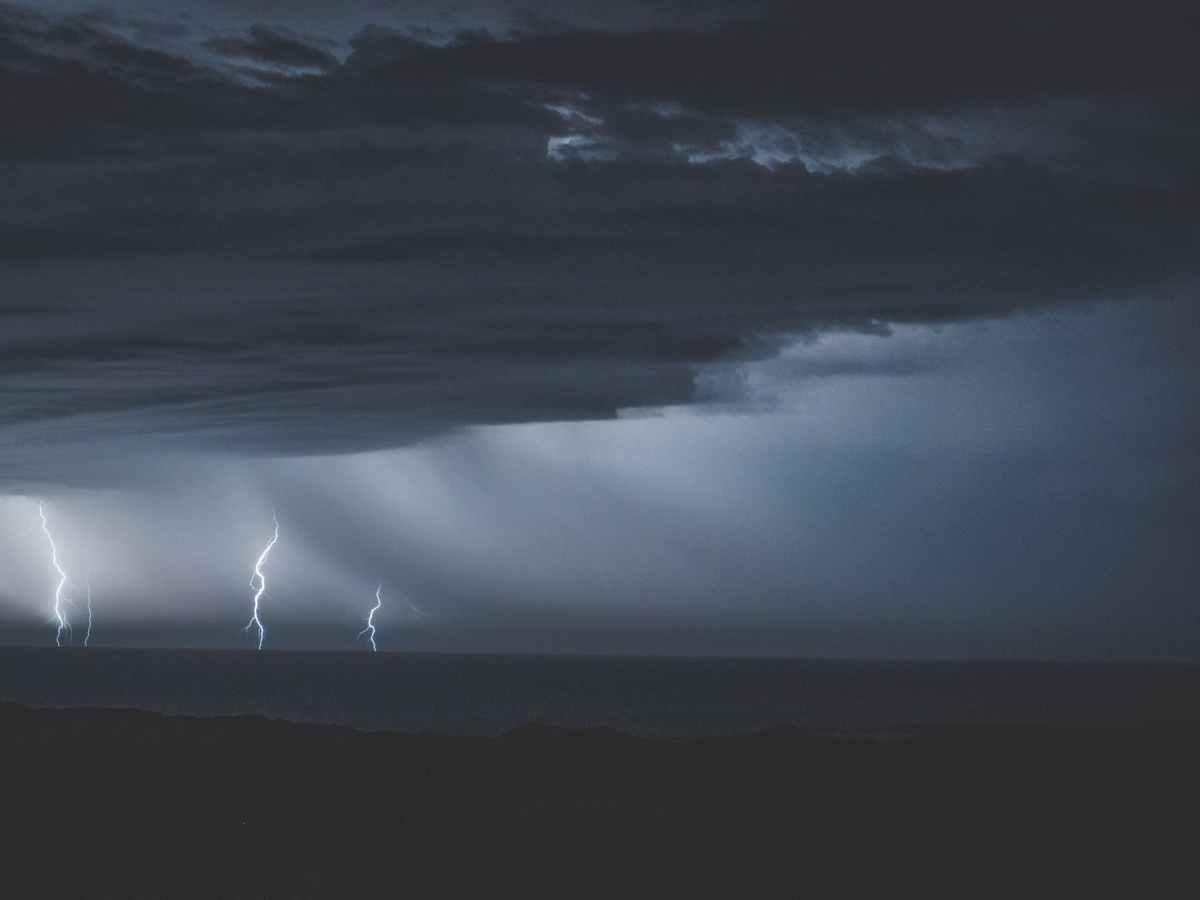 thunderstorm with glimmering lightnings over ocean
