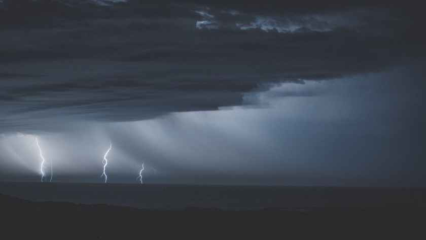 thunderstorm with glimmering lightnings over ocean