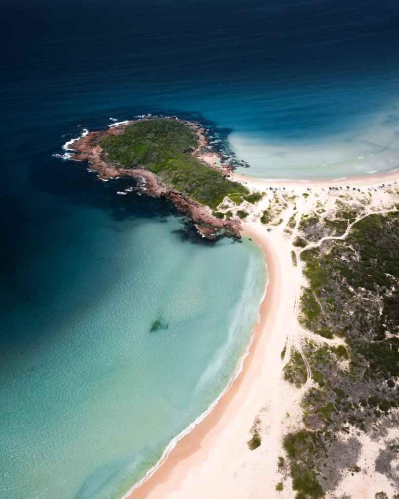 aerial view of seashore under blue sky