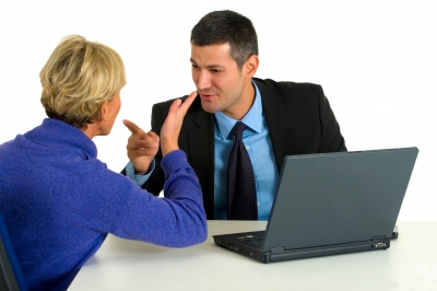 Businessman and woman arguing