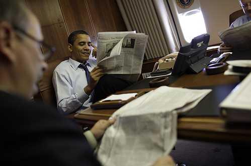 barack obama reading newspaper