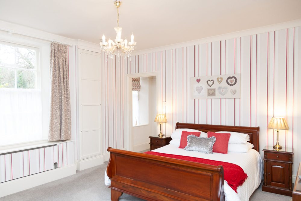 Spacious bedroom at Cockington Cottages