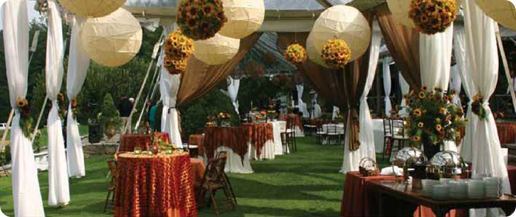 chinese lanterns with sunflower pomanders outdoor wedding reception
