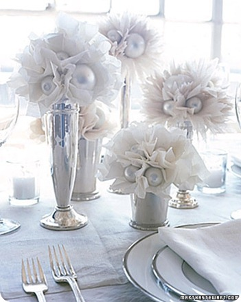 paper flowers in various vases with ornaments