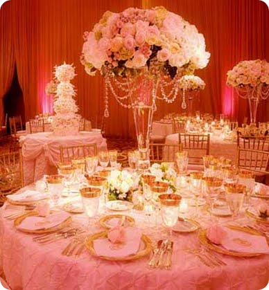 pink and ivory rose centerpiece with crystal swag draping wedding reception