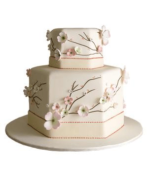 Hexagon shaped wedding cake with flowers cherry blossoms