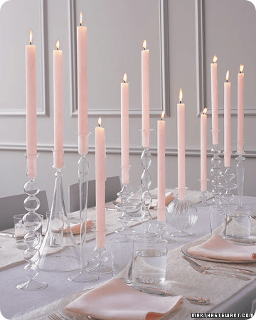 Soft color tapers in a mix of glass crystal candle holders of varying styles from Martha Stewart
