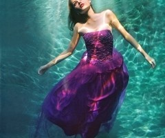 woman underwater in purple dress