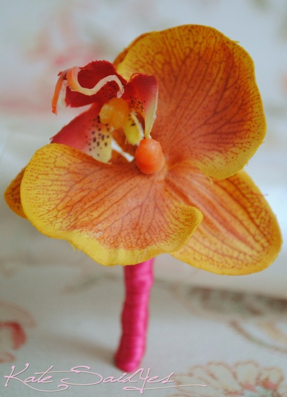 Tangerine Hot Pink orchid boutonniere