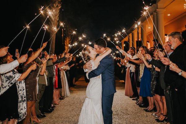 Newlyweds kissing under a shower of sparklers after their Jekyll Island wedding