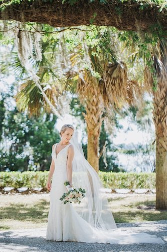 Jekyll Island bride wearing a fit and flare style gown by Casablanca Bridal carrying a pink and white bridal bouquet by Cocktails and Details