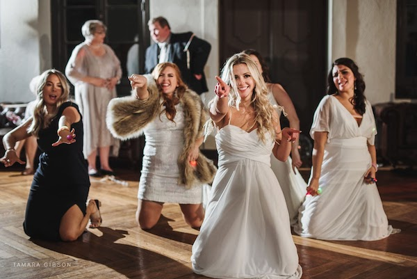 bride and friends doing a choreographed dance at her Jekyll Island wedding