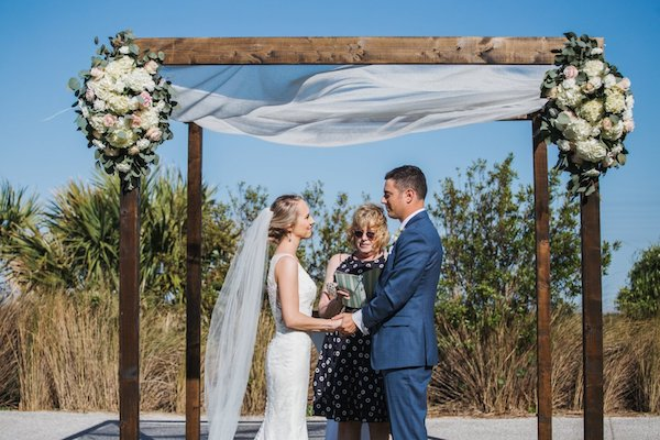 bride and groom exchanging wedding vows under a chuppah at the Westin Jekyll Island