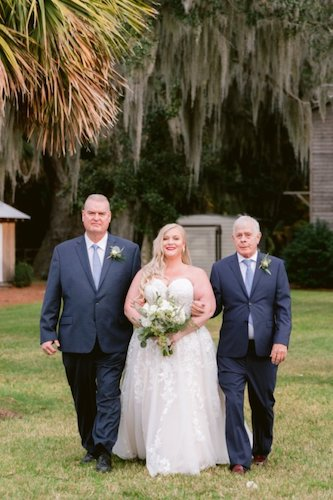 Bride being escorted down the aisle at her wedding on Saint Simons Island