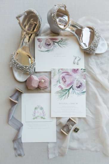 flat lay photo of bride's accessories and Badgley Mischka rhinestone wedding shoes