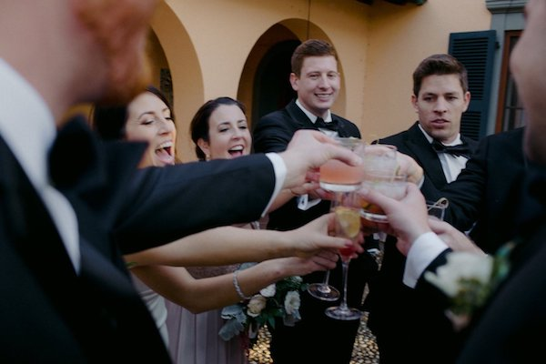 bride and groom toasting with wedding party after Villa Marianna wedding ceremony