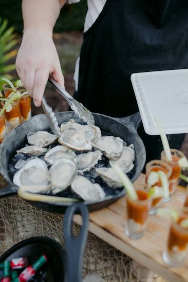 Fresh raw oysters and oyster shooters during cocktail hour at Jekyll Island wedding
