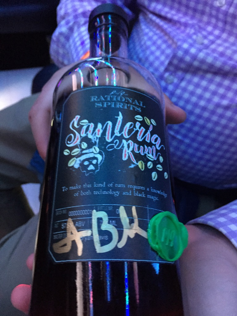 Alex Burns shows off one of the first Santeria bottles