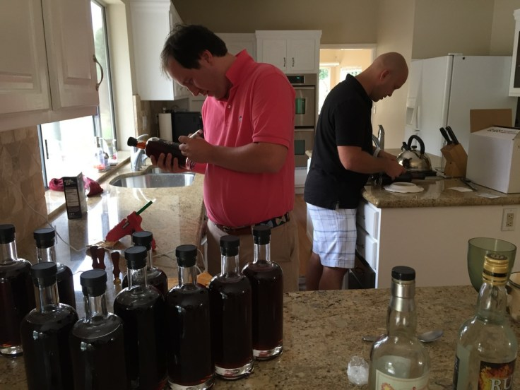 Alex Burns and Bryan Davis prepping Santeria bottles.