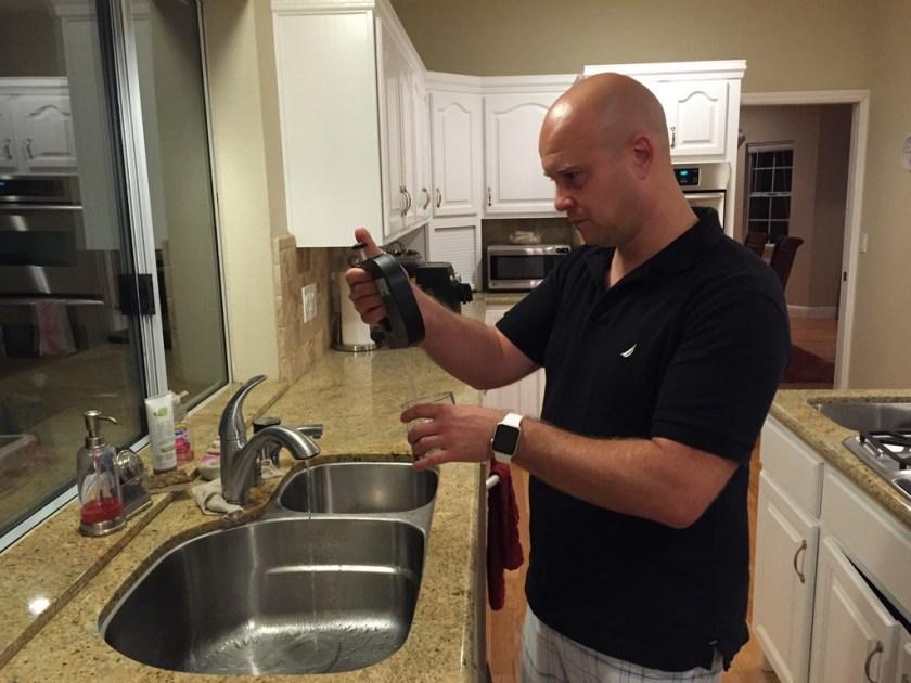 Bryan Davis proofing some aged rye for tasting.