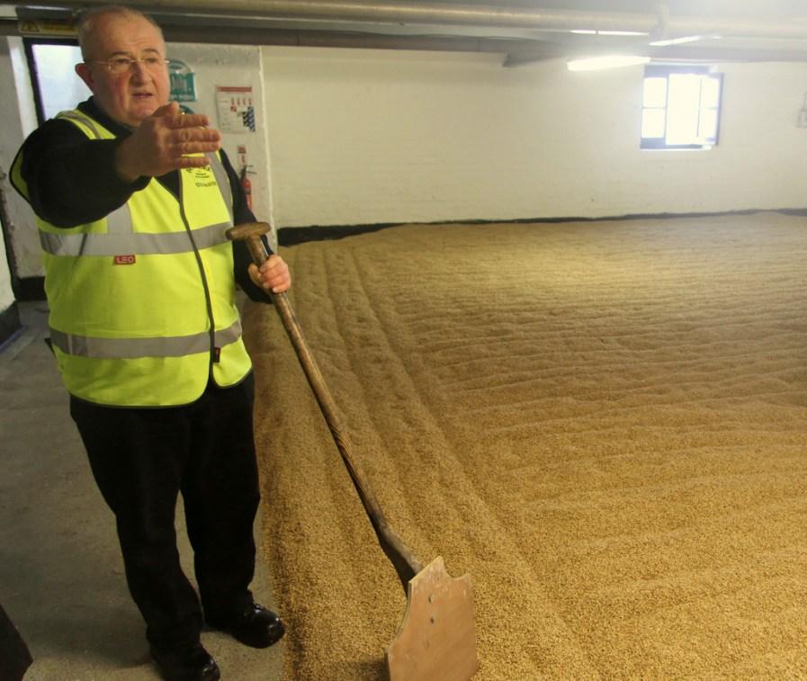 Eddie MacAffer on Bowmore's malt floor