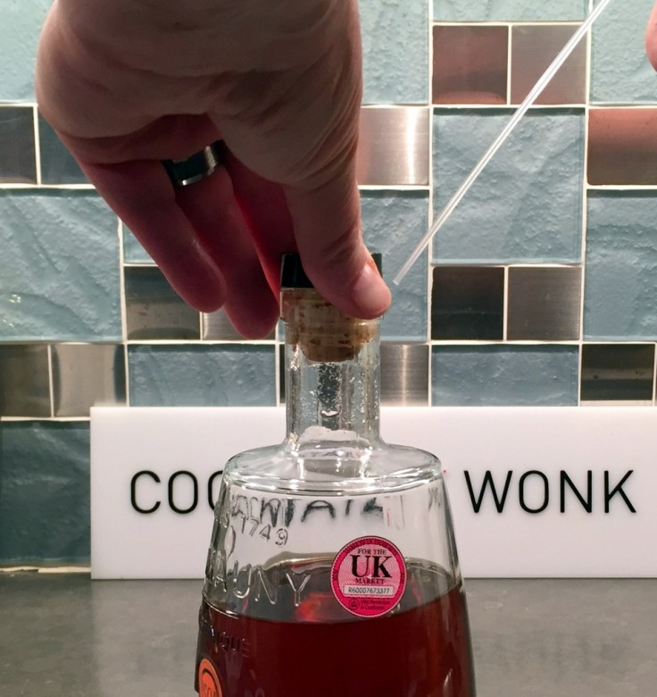 Applying wine preserver - Cork immediately after