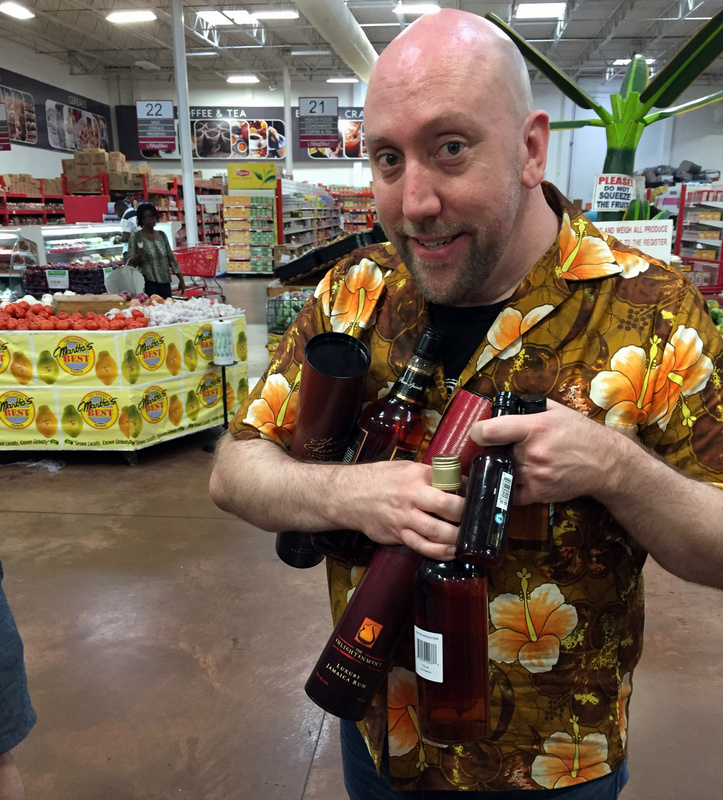 Martin Cate buying Jamaican Rum at Mega Mart