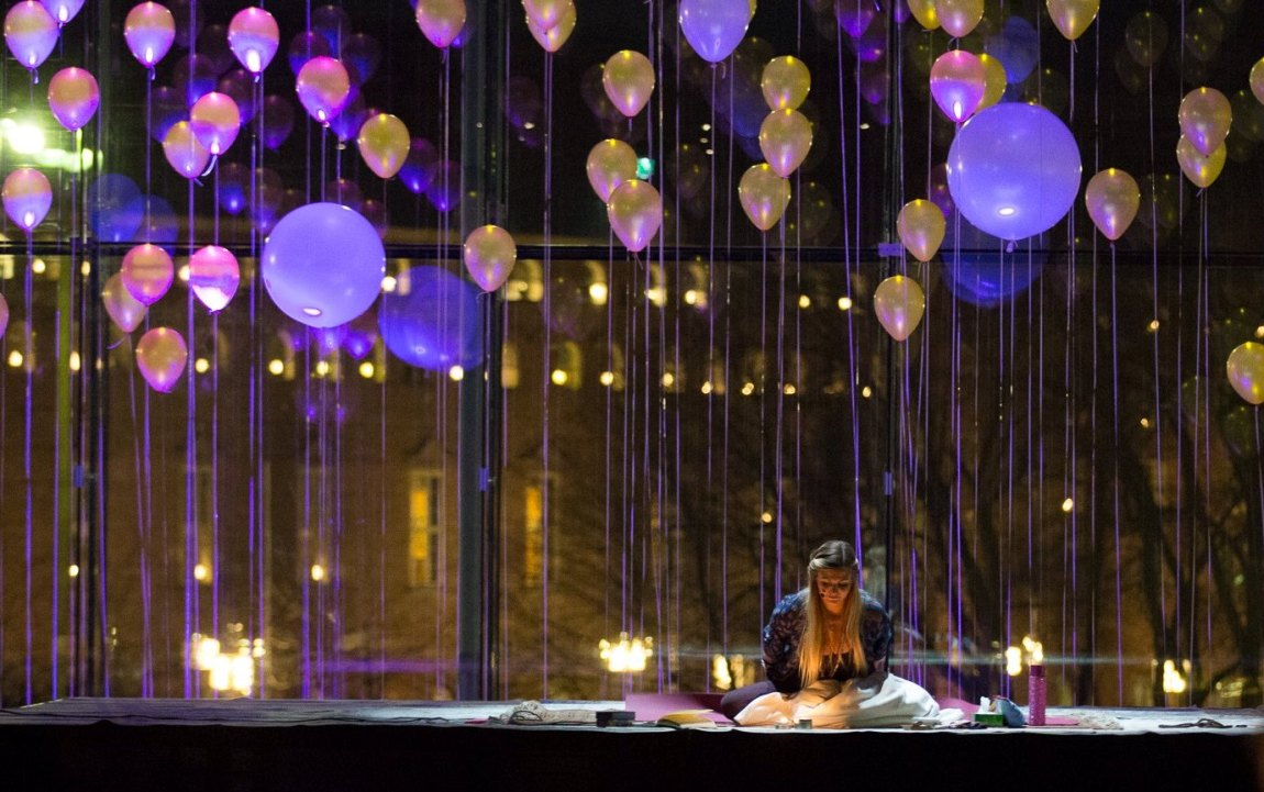 Balloons floating above the stage