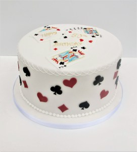 White party cake with bridge motifs and playing cards