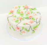 Pink Applique Flowers Anniversary Cake by Cocoa & Whey Cakes in Winchester, Hampshire