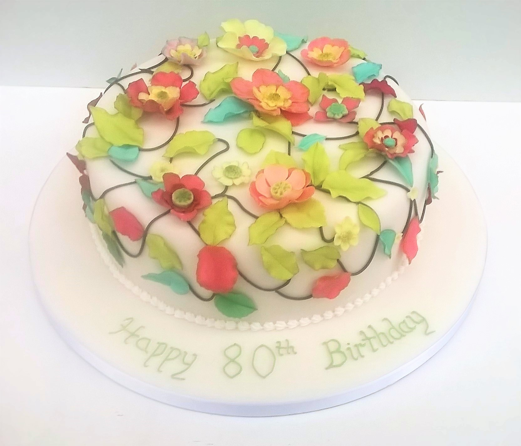 Party cake with sugar fantasy flowers and leaves