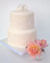 White piping embroidery wedding cake with flowers