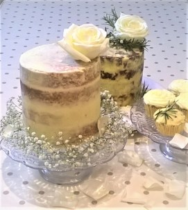 Photo of a semi-naked sweet cake and a savoury wedding cake with cupcakes