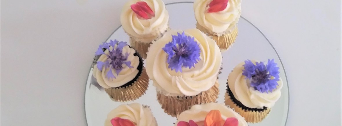 Wedding Cupcakes with Edible Flowers by Cocoa & Whey Cakes in Winchester