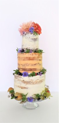 Sweet & Savoury Combination Wedding Cake by Cocoa & Whey Cakes in Hampshire showing cake tiers of vegan chocolate, cheddar & tomato & rose and almond decorated with edible flowers