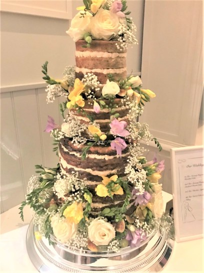 Photograph of a Savoury Wedding Cake decorated with fresh flowers