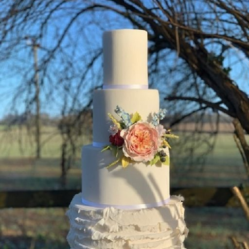 Summer Ruffle Wedding Cake with Sugar Flower Bouquet by Cocoa & Whey Cakes in Dorset