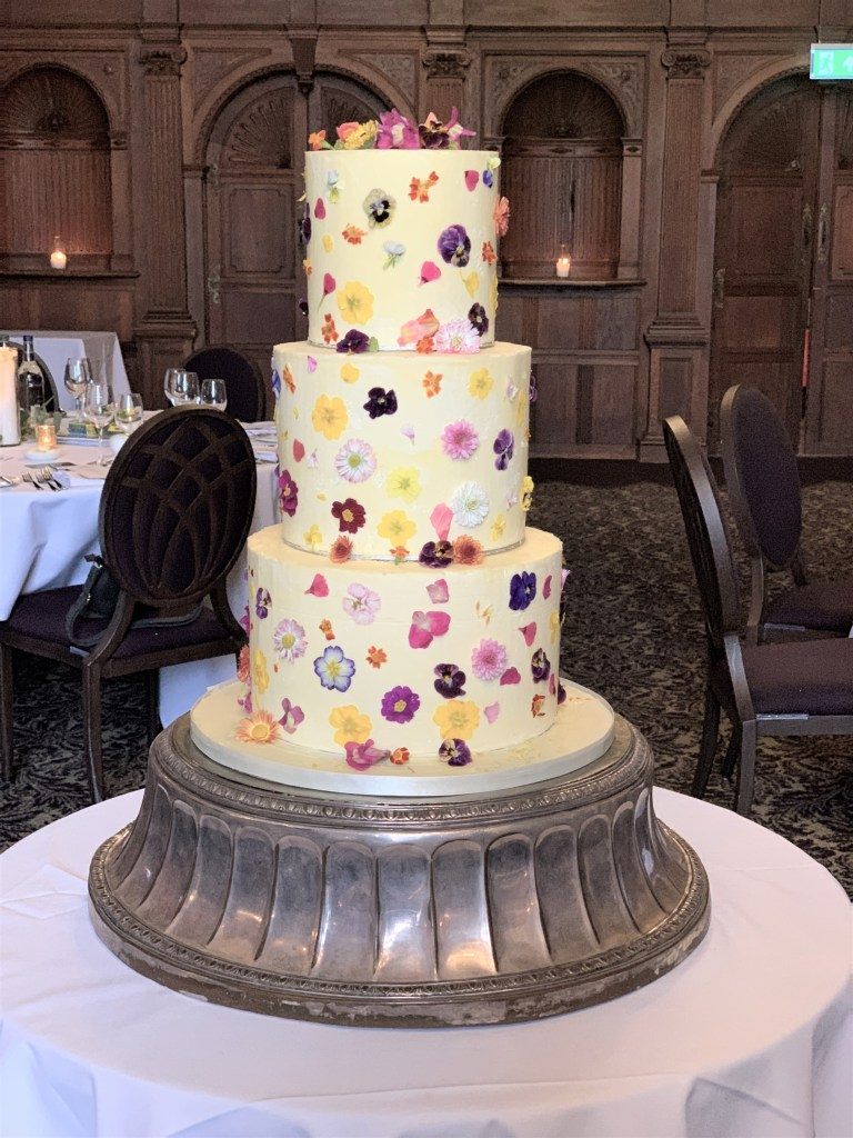 Buttercream Wedding Cake with Edible Flowers by Cocoa & Whey Cakes