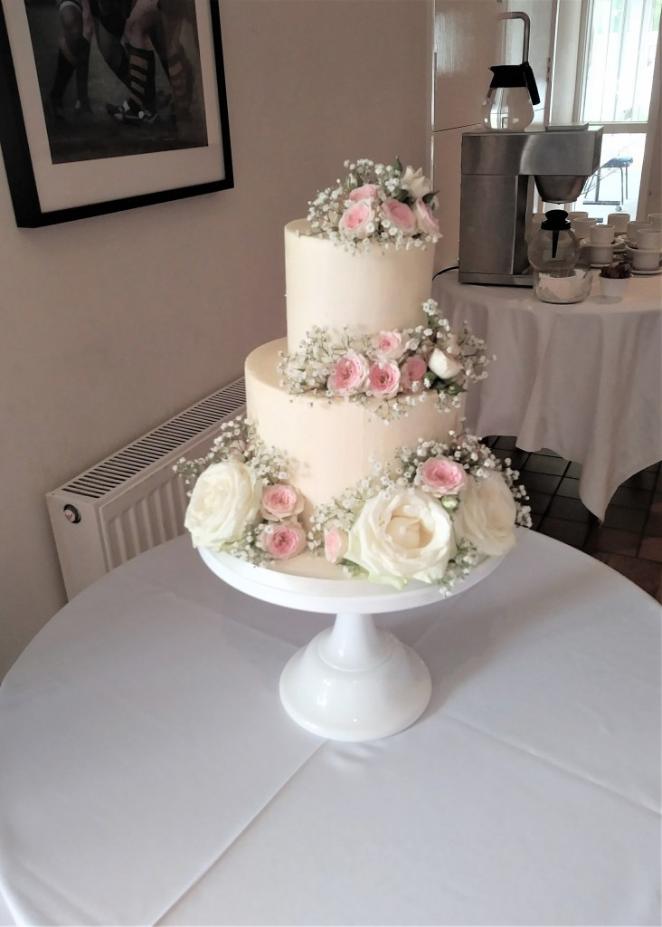Buttercream Wedding Cake with Fresh Roses by Cocoa & Whey Cakes