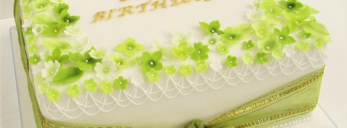 White Iced Birthday Cake with Lime Sugar Blossoms by Cocoa & Whey Cakes