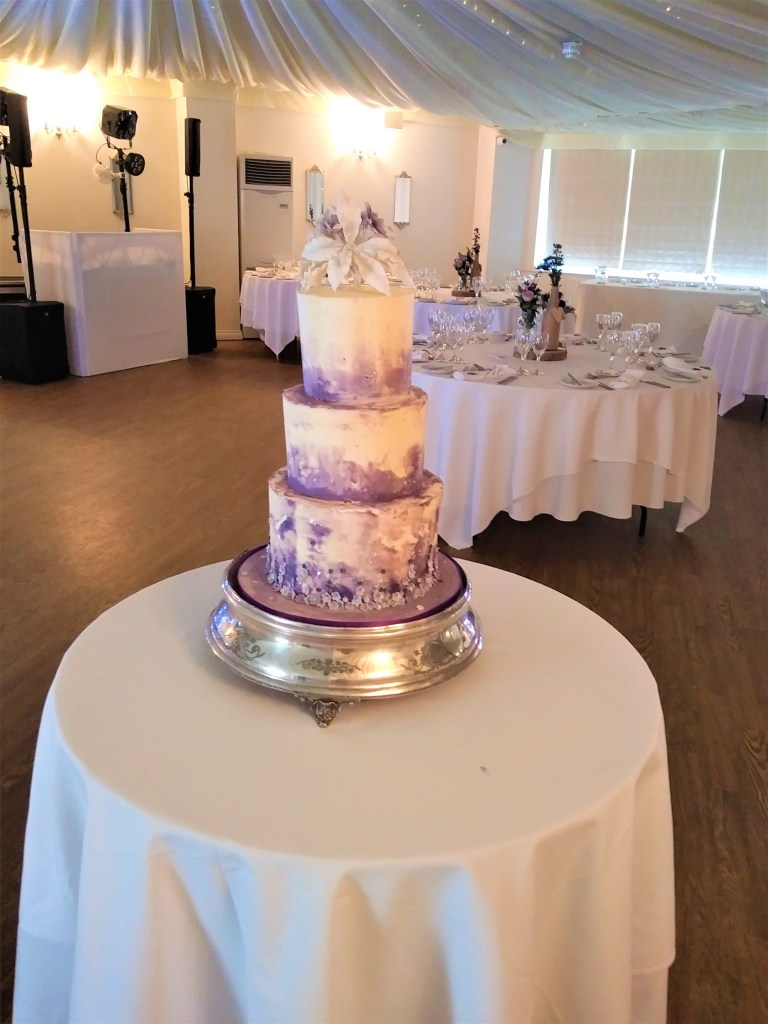 Buttercream Watercolour & Sugar Lillies Wedding Cake in Ivory & Purple by Cocoa & Whey Cakes