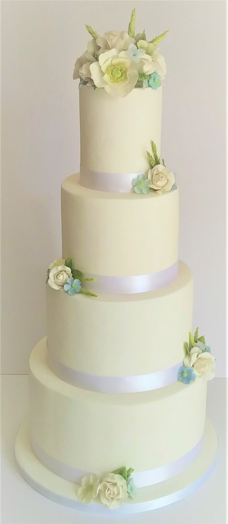 4 tier white wedding cake with sugar flowers by Cocoa & Whey Cakes in Dorset